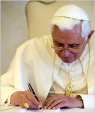 """Pope Benedict XVI signing his encyclical """"Charity in Truth"""" at the Vatican on Monday. {NYTimes}"""