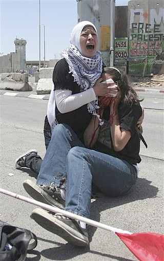 Emily Henochowicz, 21, of Maryland, underwent surgery after suffering the injury, said hospital spokeswoman Yael Bossem-Levy.  Henochowicz was hit in the face by a tear gas canister shot by an Israeli border policeman, said witness Jonathan Pollak.