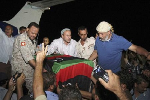 People carry the coffin of Shabaan at Misrata International Airport