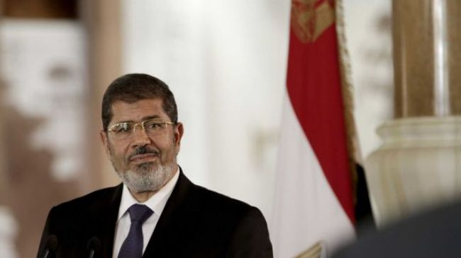 Mohammed Morsi, elected president in detention