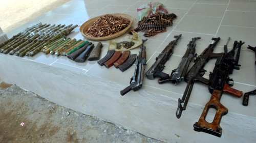 ARMS-AND-AMMUNITIONS-RECOVERED-BY-THE-JTF-DURING-A-RAID-IN-MAIDUGURI-500x281