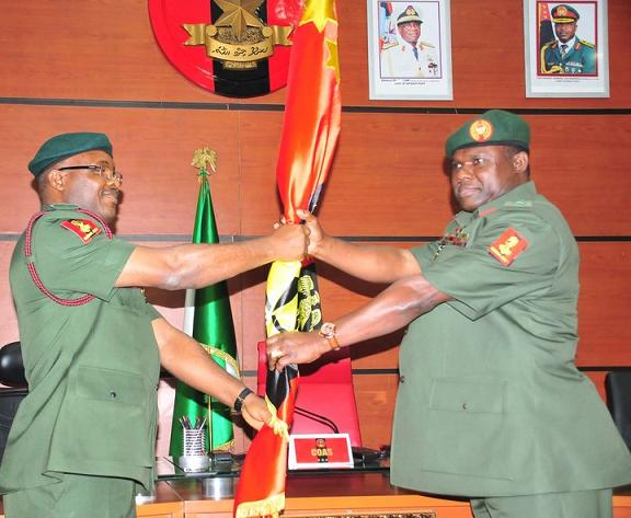 Morbidly oObese army chief Kenneth Minimah on right
