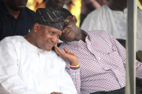 Fashola and Dangote conspiring at a town meeting some weeks back