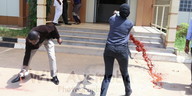 Japeth Omojuwa and Azeerah Mohammed at the Ministry of Interior this week, painting it red