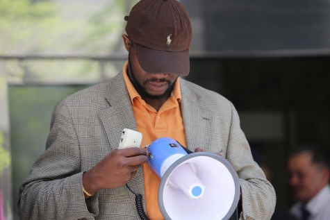 Dr. Peregrino Brimah prepares to speak at #BringBackOurGirls rally, Nigerian embassy, New York, USA, May 6, 2014