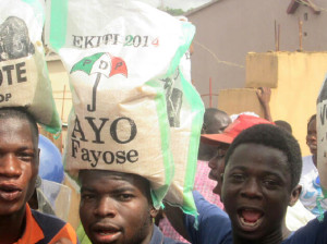 STUDENTS WITH ITEMS DISTRIBUTED BY PDP GOVERNORSHIP  CANDIDATE, MR AYO FAYOSE IN ADO-EKITI ON FRIDAY (13/06/14). 3722/13/06/2014/JIG/CH/AIN/NAN