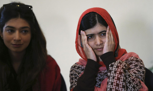 Pakistani schoolgirl activist Malala Yousafzai reacts as she listens during a meeting with the leaders of the #BringBackOurGirls Abuja campaign group, in Abuja
