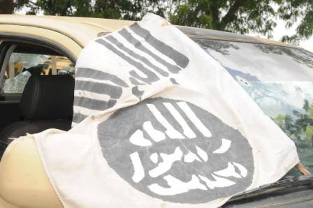Flag of the terrorists on one of the captured vehicle by Nigerian troops in Konduga