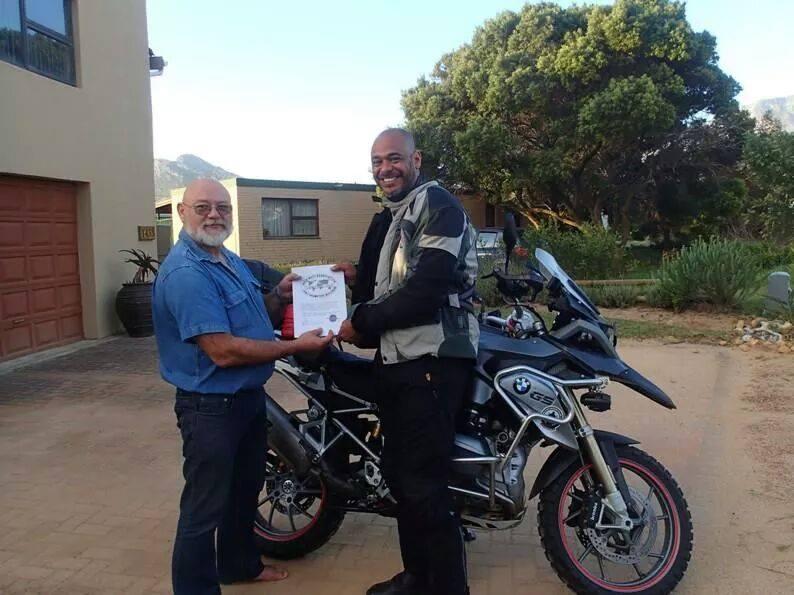 Receiving the Iron Butt Association Membership from President, Hendrik