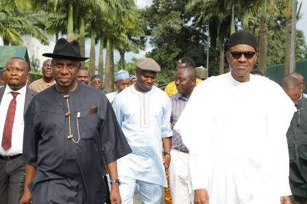 Dr. Dakuku Peterside, in white kaftan and Fez cap, walking behind Gen. Mohammadu Buhari(rtd.) and Governor Chibuike Amaechi