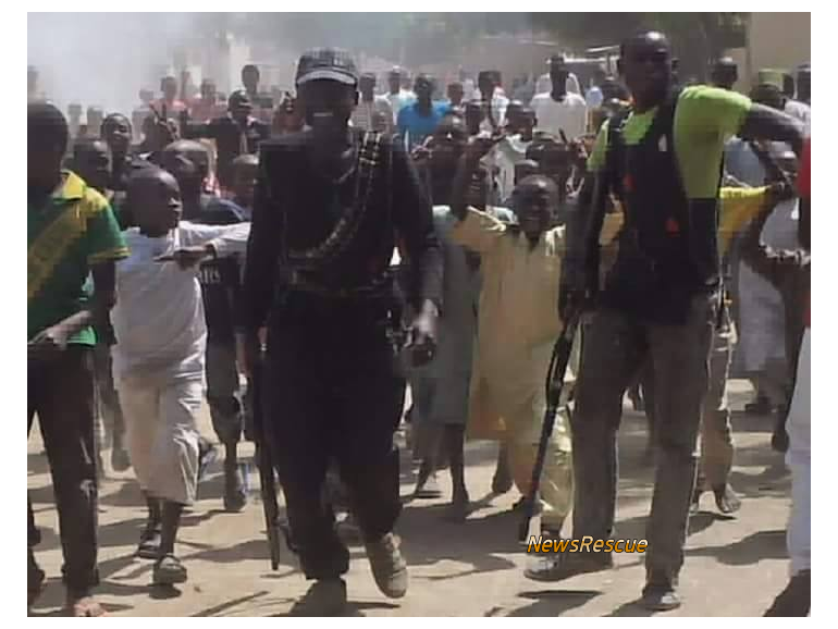 Civilian JTF celebrate after dispelling Boko Haram, capturing APC's and artillery guns
