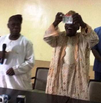 Obasanjo-tears-PDP-card