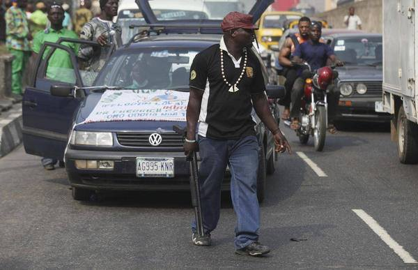 OPC terrorists hired by Jonathan display weapons on Lagos streets with military backing