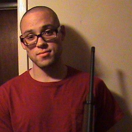 Me, holding a rifle. It was supposed to be all the way in the picture, but it didn't work out. Only the barrel shows.