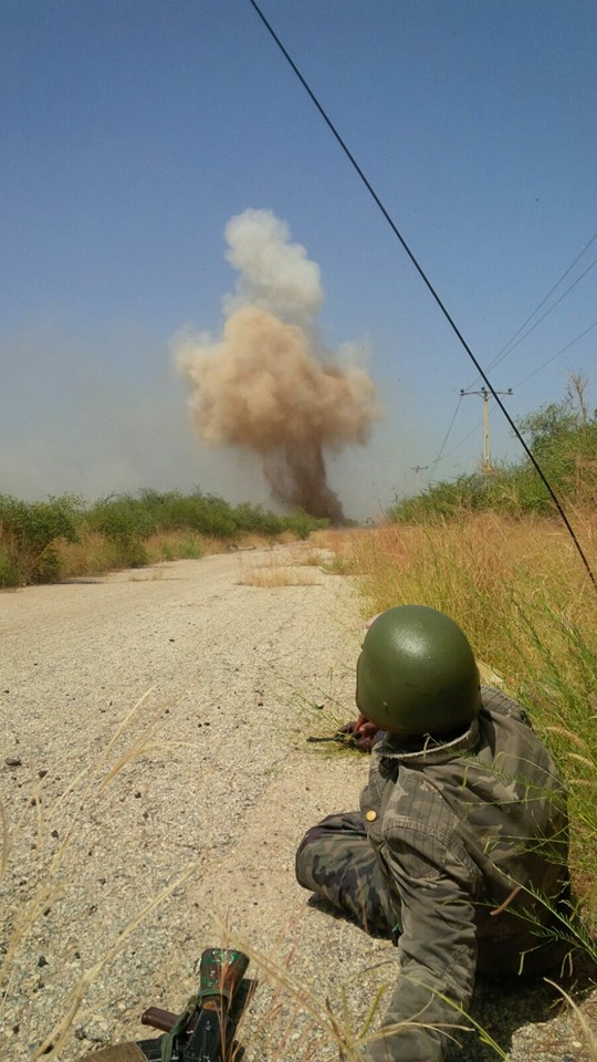 Detonating the IED by the troops.