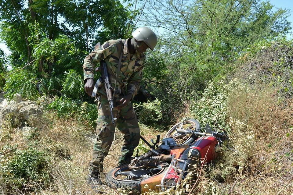 Soldier recovering more motorcycle abandoned bybthe terrorists.