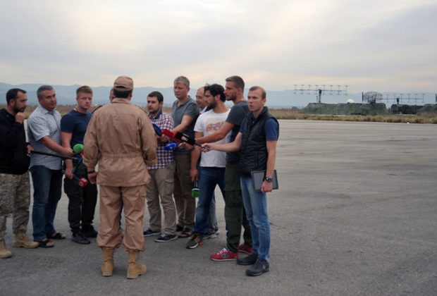 2746112 11/25/2015 Rescued pilot of the Russian Air Force's Su-24 jet, Captain Konstantin Murakhtin, center, answers journalists' questions at Khmeimim Air Base in Latakia. Dmitriy Vinogradov/Sputnik
