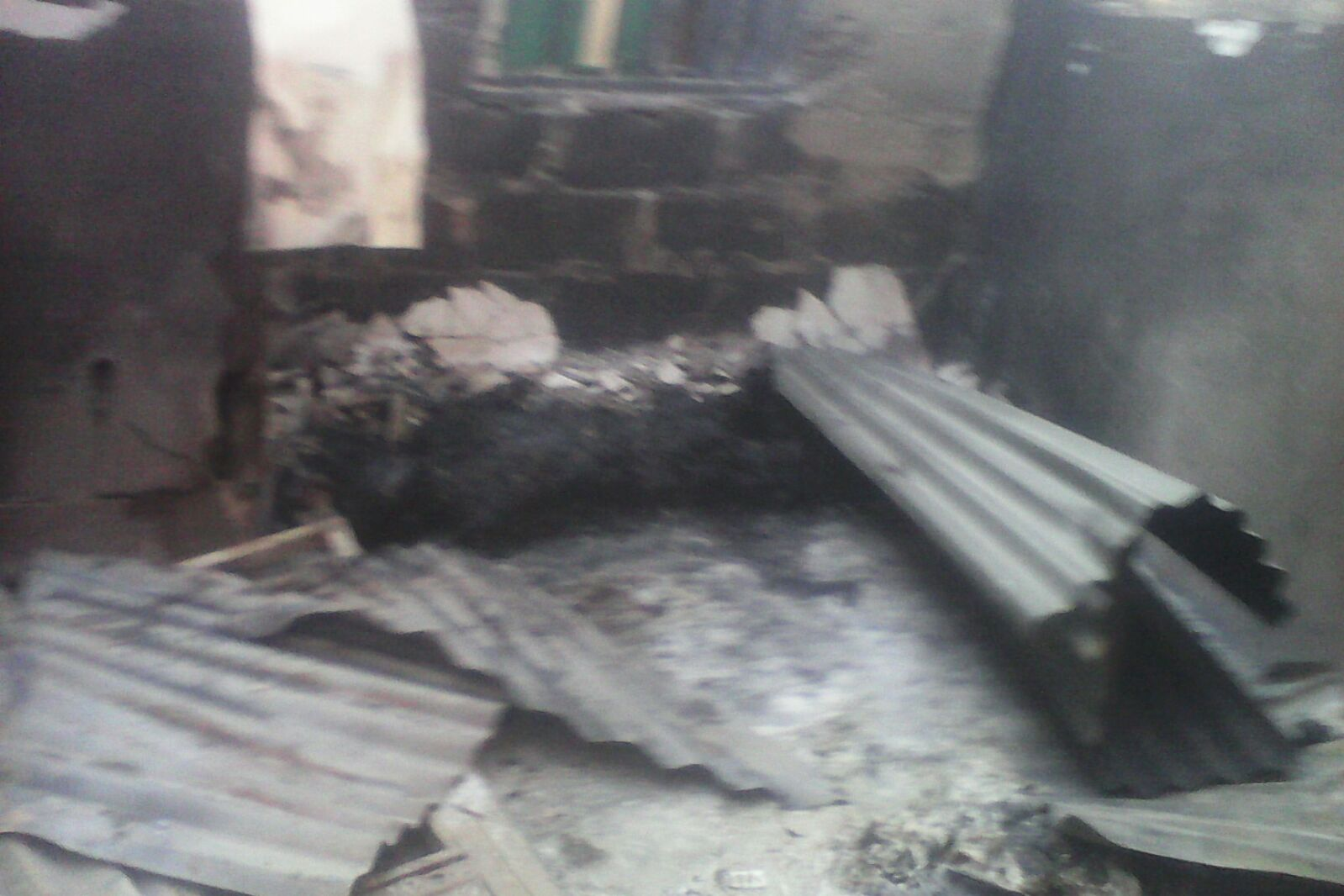Images from Attack: House where people were locked in and burned to death