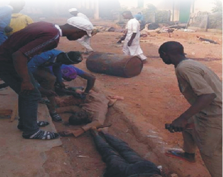 Victims' bodies left by the Nigerian Army for looters
