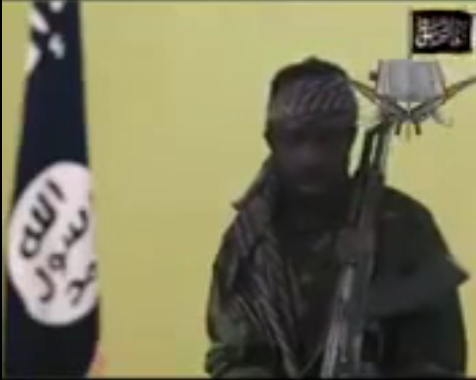 Shekau retirement video with ISIS flag behind him