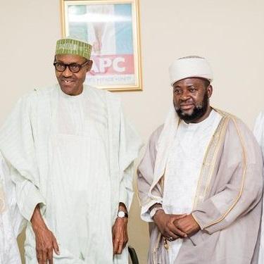 Nigeria's president Muhammadu Buhari stands with Izala leader Bala Lau, April 2015