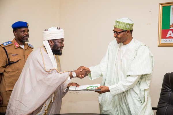 Bala Lau bows for President Buhari in April of 2016 after he won the Presidency